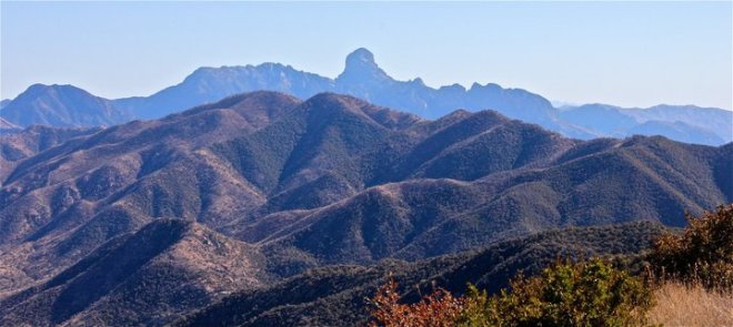 "Baboquivari Peak, meaning ""skinny in the middle"" is thought to have once been taller and narrow where the current peak is now. It is the most sacred mountain on the Tohono O'odham Nation."
