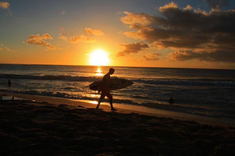 I kind of like this photo, but I wish I had been quick enough to snap it when the surfer was standing directly in front of the Sun.