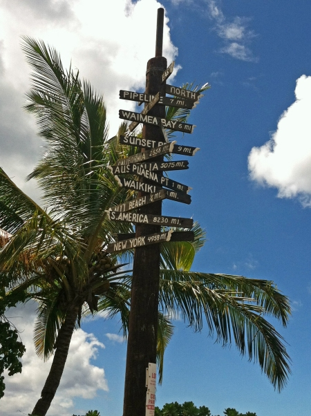 Fun sign in Hale'iwa detailing how far away different cities and countries are.