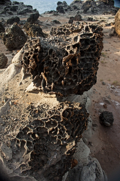 Rocks that look as if they have been washed in acid - the result of years of ocean erosion.
