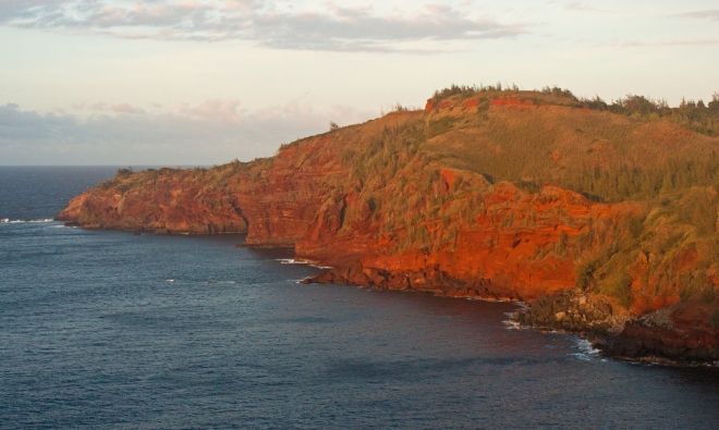 Driving back to Lahaina, the setting sun made these already red rocks look even more vibrant.