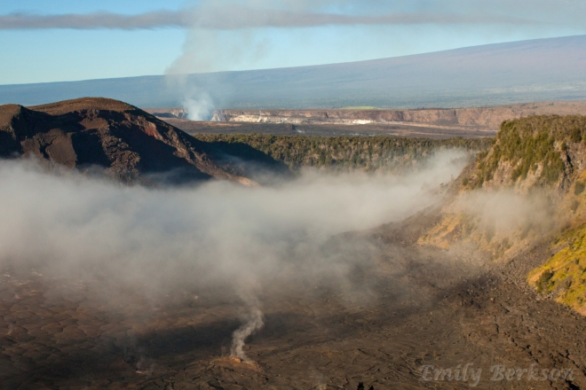 Steam rises from cracks in the lava floor of Kilauea Iki Crater.