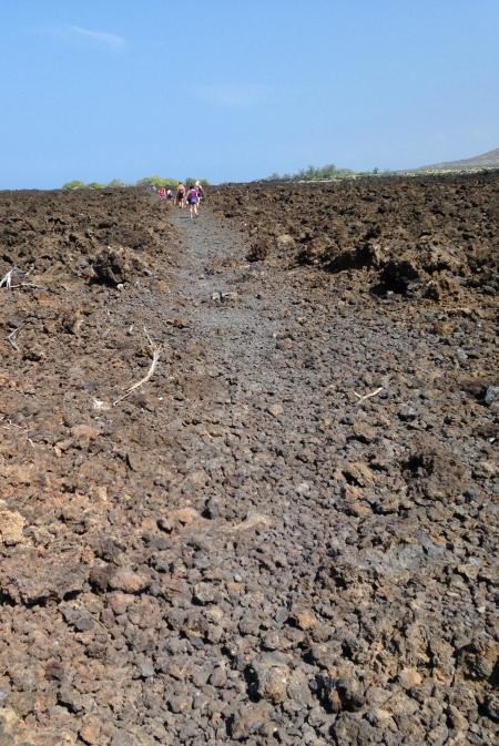 Hiking along a lava field toward Makalawena.