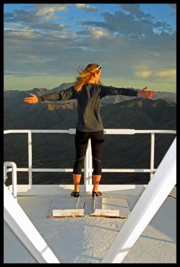 Doing the Titanic pose at the top of the 100-foot tower