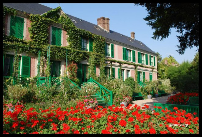 Monet's home, on a much sunnier day than when we visited. (Image Credit: Ariane Cauderlier, http://giverny.org/gardens/fcm/visitgb.htm)