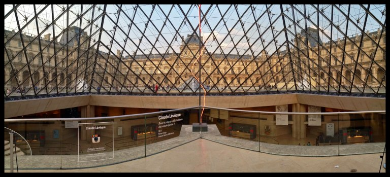 Inside the famous Louvre pyramid.