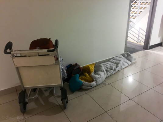 Sleeping in a corner of the Santiago Airport.
